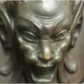 Evil face carved in wardrobe